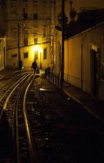 Lisbonne, Barrio Alto (Bernard Chevalier) Tags: street city solitude femme tram ombre rails nuit ville barrioalto lisbonne rverbre