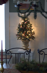 Small Christmas tree in dining room (kizilod2) Tags: christmas tree urn table gold walnut rosehip