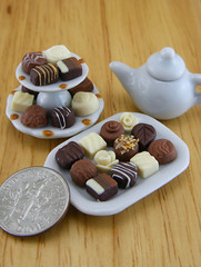 Luxury Pralines (Shay Aaron) Tags: food white scale dark dessert miniature milk candy handmade aaron fake mini jewelry polymerclay fimo biscuit tiny faux shay handcrafted 12th 112 geekery bittersweet jewel petit praline twelfth weeny pastryshop chocolatechipscookie shayaaron wearablefood bakeryboutique