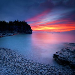 Bye Bye Blue Bruce Peninsula (Nathan Bergeron Photography) Tags: longexposure blue trees sunset ontario canada colour beach water clouds landscape nationalpark nikon rocks shoreline pebbles cliffs nikkor brucepeninsula tobermory fireinthesky nikkon nikkorlens 1635mm thebrucetrail indianheadcove leefilters lachuron nikond700 nikon1635mm
