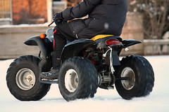 Racing with a quad (Suzanne Talens) Tags: christmas winter people snow ice youth driving sneeuw quad racing riding ijs jongeren racen rijden snelheid spead