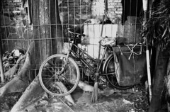 Bike 1/8 Cikini Menteng (DMahendra) Tags: street people urban blackandwhite bw film canon indonesia streetphotography iso jakarta 400 ql17 asa400 canonetgiiiql17 menteng cikini jakartapusat centraljakarta cikiniraya