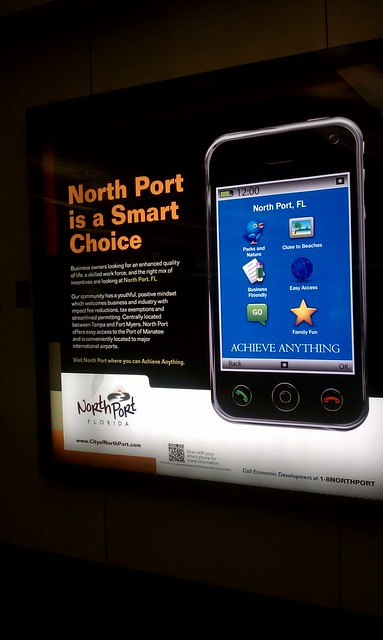Info display at the Orlando airport with a QR tag.