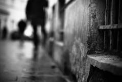 Adversary (ewitsoe) Tags: city winter people blackandwhite bw cold wet wall 50mm nikon europe bokeh poland polska krakow east sidewalk streetshot jewishquarter strret d80