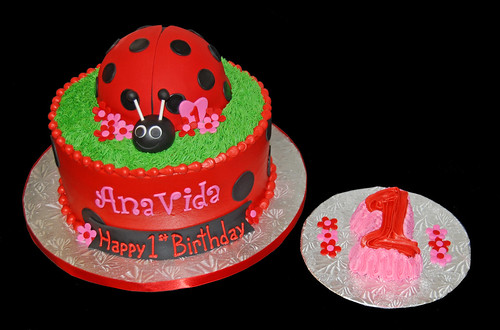 red and black lady bug cake with pink accents - first birthday