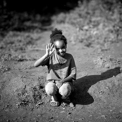 """Farenji!""  Ethiopia (Eric Lafforgue) Tags: africa people blackandwhite girl childhood youth outside outdoors person kid child noiretblanc fulllength jeunesse innocence ethiopia waving enfant fille naivete personne humanbeing contemplation afrique dehors salut eastafrica thiopien enfance carre abyssinia ethiopie etiopa exterieur lookingatcamera blackandwhitepicture squarepicture enpied bebeka abyssinie  vueexterieure etiopija ethiopi  etiopien etipia 0437  etiyopya  photoenpied afriquedelest etrehumain    photoennoiretblanc   regardantlobjectif    imagecarree plantationdecafedebebeka bebekacoffeeplantation"
