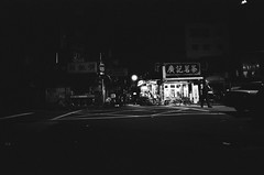 Dark life (Yubai K) Tags: street old light urban blackandwhite bw man film night last corner dark nikon asia mood loneliness quiet sad time tmax decay district cigarette taxi taiwan stall smoking silence midnight streetphoto lonely taipei   nostalgie backlanes fm2n