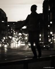 Aalborg Late Afternoon (H. Hille) Tags: street city nightphotography winter portrait bw woman girl night dark denmark lowlight jung nacht availablelight young streetphotography stadt danish sw frau dnemark danmark balancing dunkel aalborg balancieren strase dnisch canonef70200mmf28lisusm canoneos500d