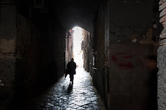 The Approach (TheFella) Tags: italy slr rain digital canon eos photo alley europe italia arch trenchcoat photograph alleyway figure processing napoli naples getty lone dslr 500d southernitaly twtmespw