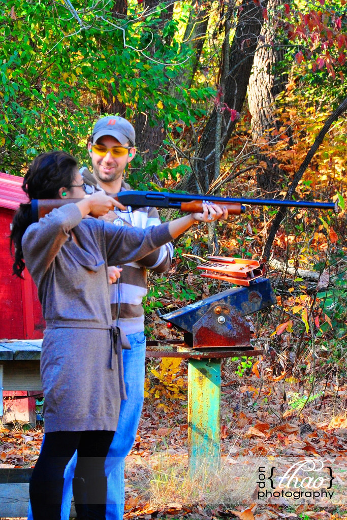 holding a 12-gauge shotgun like a bazooka