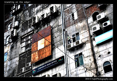 Standing on the edge! (.::Sajid Photography::.) Tags: city windows urban abstract building window wall floors standing work fix daylight office nikon day cityscape risk board fineart bricks working lifestyle airconditioner human edge worker fixing dhaka job protection sign