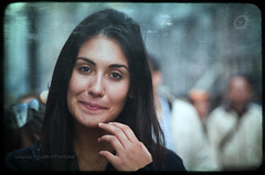 Captivate (Yug_and_her) Tags: street travel portrait italy milan girl beautiful smile face hair eyes hand open fingers shy expressive captivate mesmarize