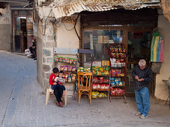 Corner shop (Evgeni Zotov) Tags: street old city roof boy people man money window shop children stand kid asia child pavement middleeast chips arab sit syria damascus count siria syrian  syrien syrie suriye  syri   sria