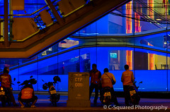 Structural Integrities #006 (triangular) Tags: blue urban orange colors lines yellow electric architecture night buildings thailand nikon colorful asia power availablelight bangkok escalator 85mm architectural ambient techno motorbikes 006 urbanlandscape samyang d7000 nikond7000