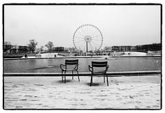 ... (oscarinn) Tags: blackandwhite snow paris france blancoynegro december loneliness chairs days francia tulerias