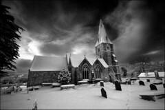 'Winter Scene' - Llanfaes Church, Beaumaris (Kristofer Williams) Tags: winter snow church graveyard clouds cross sony alpha beaumaris llanfaes a550