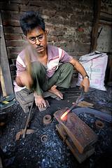 Blacksmith (Apratim Saha) Tags: india man indian blacksmith westbengal siliguri apratim apratimsaha
