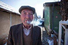 Viden (Uros Jonic) Tags: life old winter portrait people sun house man cold detail male home uros nature face closeup outdoors photography photo cigarette smoke smoking casual feeling dim enjoyment oneperson jonic colorimage cigareta lookingatcamera outdor  70plusyears