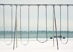 snowswings (lucy.loomis) Tags: ocean winter light sky snow beach harbor swings swingset hyannis veterans
