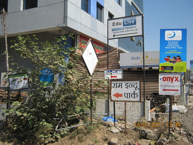 Sign boards on Baner Road say a lot about Ram Indu Park in which A J Serene, 3 & 4 BHK Duplex, is located.