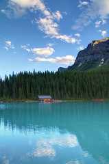 Solace (Jim Boud) Tags: travel blue red sky mountain lake snow canada reflection building tree green nature water pinetree clouds forest canon lens landscape outdoors eos boat nationalpark cabin colorful hiking rental wideangle canadian canoe glacier shore alberta northamerica banff dslr lakelouise 1785mm digitalrebel photoart digitalslr pinetrees province firtree waterscape artisticphotography superwideangle canadianrockies photomatix 550d jimboud t2i hybridhdr exposurefusion jamesboud eos550d kissx4 blendlayers