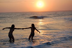 True happiness (Candid Captures by Carol) Tags: ocean sunset beach water swimming happy waves glow dancing award outerbanks magical day21 day22 niedersterreich obx demonstratie mondfinsternis malieveld tamborrada 2011 beautifulpicture jan21 photographyrocks daysixteen daytwentyone nikond40 project36521 colorphotoaward flickraward cpbrasil day21365 nikonaward tipsytuesday nicesmilesir fotosndag ds427 ds432 carolknepp