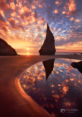 Vertical Wizards Hat, Bandon Oregon (Chip Phillips) Tags: ocean winter sunset sea reflection beach clouds oregon coast sand pacific northwest stack shore bandon abigfave stunningskies