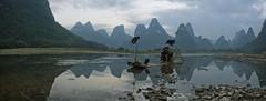 the silence (ANOTHER DAY AT THE OFFICE) Tags: xingping lijiang li river adventure panorama karst hill guangxi yangshuo cormorant fishermen fisherman travel