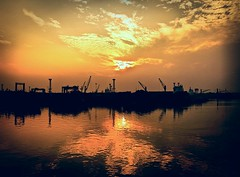 Leaving Calcutta... (Jerry Tremaine Photography) Tags: calcutta kolkata india asia dockyard hoogli river boat sunset clouds reflection justclouds