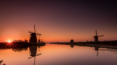 The first rays of the day (Mika Laitinen) Tags: canon7dmarkii europe kinderdijk leefilters netherlands tokina1116mm architecture calm canal color landscape nature outdoor sky summer sun sunrise water windmills zuidholland nl ~themagicofcolours~xiv