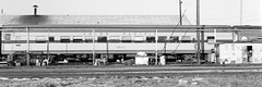 Amtrak's former Budd Union Pacific coach # 5525, is located at the SCL (former ACL) railroad yard and maintenance shop facility in Saint Petersburg, Florida, 1973 (alcomike43) Tags: old railroad blackandwhite bw up shop yard train vintage coach tracks rail historic negative amtrak photograph unionpacific acl scl passengertrain seaboardcoastline railroadyard maintenanceshop atlanticcoastline conventionallightweightpassengercar