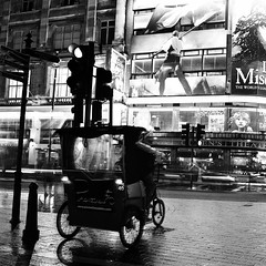 London (Peter Gutierrez) Tags: street uk light england bw white motion black streets london english film public night square lights evening noche photo moving movement europe european nocturnal traffic nacht britain circus pavement united soho great picadilly kingdom move sidewalk peter gutierrez british rickshaw nuit brit nocturne notte brits europeans petergutierrez