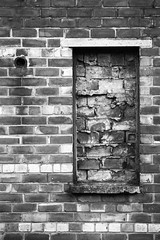 More Bricked-up-ness (Lovely Like Custard) Tags: road street uk winter shadow england urban bw white black west colour brick church window monochrome up wall digital canon geotagged manchester photography eos grey mono photo lucy december photographer cheshire image pavement path no tag north gray like tagged explore photograph stockport frame custard sk behind lovely 50 exploration geo geotag sreet ue 2010 urbex shires bricked 450d talkurbex