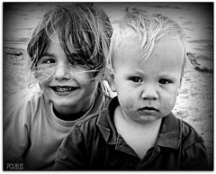 Love is the only sane and satisfactory answer to the problem of human existence.  ~Erich Fromm~ (BurstsofSingleMindedness) Tags: bw beach kids contrast son niece oostende doubleportrait childrenphotography