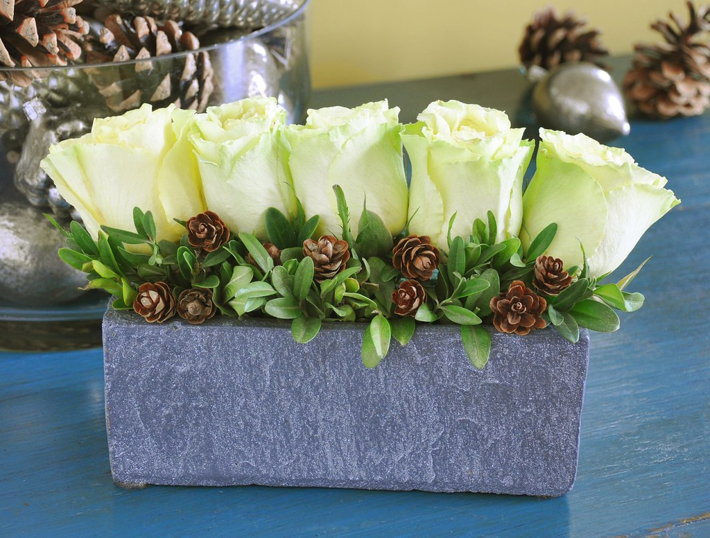A Modern Christmas Arrangement Using Green Roses