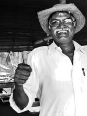 Thumbs up! (Maron) Tags: india wet smile restaurant varkala thumb supermarion marionnesje