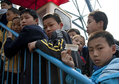 Children queueing to ride the big wheel Pyongyang North Korea (Eric Lafforgue) Tags: people color colour childhood horizontal youth stairs children person togetherness kid war asia child capital steps rail korea jeunesse communism together innocence asie enfants capitale coree enfant ensemble escalier naivete personne couleur humanbeing communisme northkorea pyongyang marches dprk enfance coreadelnorte lookingatcamera rambarde nordkorea colorpicture waistup lowangleshot 3651 contreplongee democraticpeoplesrepublicofkorea    coreadelnord  etrehumain coreedunord  insidenorthkorea  rpdc  regardantlobjectif kimjongun coreiadonorte  republiquepopulairedemocratiquedecoree cadragealataille
