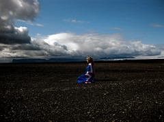 Looking to the Future (Elsa Prinsessa) Tags: blue portrait woman black clouds iceland sand desert flag glacier elsa bjrg magnsdttir elsaprinsessa
