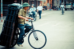 delivery on bicycle (Adam Lai) Tags: man bicycle vietnamese vietnam busy motorcycle delivery hanging hanoi panning squeezing