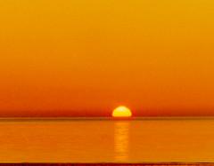 Sunset on the Irish Sea (billnbenj) Tags: sunset orange reflection scanner cumbria barrow irishsea orangeglow biggarbank scannedenegative