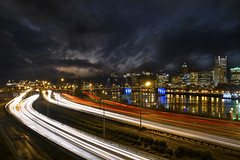 Freeway Light Trails and Downtown Portland Oregon Skyline at Night - HDR (David Gn Photography) Tags: road park city travel blue light sky motion blur reflection cars skyline night clouds oregon river portland lights star evening highway long exposure downtown industrial cityscape waterfront traffic dusk district trails bridges dramatic peak vehicles hour transportation freeway esplanade pdx hours rushhour morrison hawthorne metropolitan speeding hdr willamette burnside bursts eastbank 3xp canoneos7d sigma2470mmf28ifexdghsm