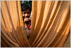 Little Miss Sunshine [..Chuadanga, Bangladesh..] (Catch the dream) Tags: orange girl smile yellow rural children pattern child rustic shy fold cloth saree bangladesh folding regular villagegirl girlchild sharee chuadanga regularpattern ruralgirl alamdanga foldsincloth gettyimagesbangladeshq2