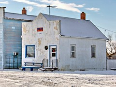 SK10m12 Wiseton Post Office, Saskatchewan 2010 (CanadaGood) Tags: white snow canada color colour building flag postoffice sk prairie saskatchewan 2010 canadapost milden wiseton canadagood thisdecade