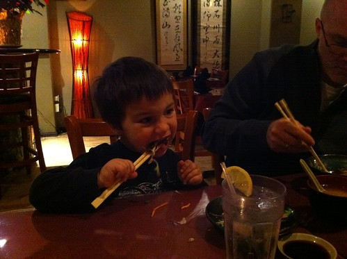 Finn eats salad with chopsticks