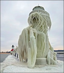 Aftermath of the Winter Storm (Tom Gill.) Tags: winter lighthouse lake ice frozen day cloudy michigan stjoseph lakemichigan greatlakes rangelight stjosephriver outerlight innterlight frozenlighthouse icecoveredlighthouse