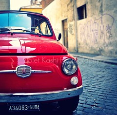 Little Red Fiat (Violet Kashi) Tags: street red summer italy rome roma classic car closeup mediumformat reflections photography graffiti nikon shiny fiat cobblestones picnik fiat500  d90