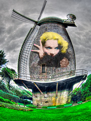 Larger-than-Life Movie Star Marlene Dietrich is Blowing Through the Windmills in My Mind, Montage (Walker Dukes) Tags: sanfrancisco california pink blue trees woman brown black green art texture film beautiful beauty television collage clouds photoshop canon hair lens wooden screenshot glamour eyes rust distorted shingles gray young fisheye age hollywood blonde actress filmstill filmstills actor fingernails transparent trippy benches diva tcm shrubs corrosion moviestill turnerclassicmovies oldmovies photomatix picturesofthetelevision tonemapping televisionshot canons95