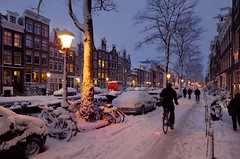 Passing on a cosy feel this winter (Bn) Tags: city bridge winter snow sinterklaas amsterdam bike nightshot bikes biking