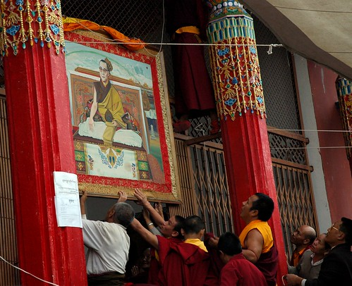 Buddhists installing a portrait of His Holiness The 14th Dalai Lama over the entrance to Tharlam Monastery of Tibetan Buddhism, in honor of winning USA Congressional Gold Medal, Sakya Lamdre, Boudha, Kathmandu, Nepal