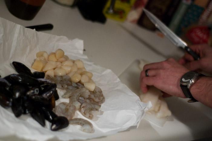 Andrew making dinner.
